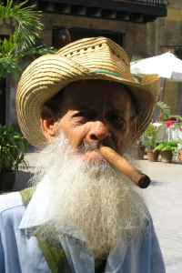 old man with big beard and cigar